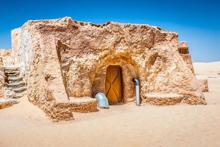 Buildings in Ong Jemel, Tunisia. Ong Jemel is a place near Tozeur, where the movies Star wars Фото со стока