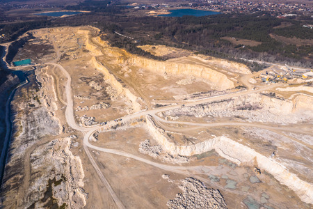 Aerial view of degraded landscape. Destroyed land. View from above. Industrial place
