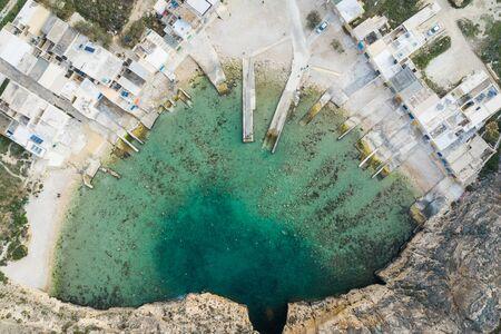 Dwejra is a lagoon of seawater on the island of Gozo. Aerial view of Sea Tunnel near Azure window. Mediterranean sea. Malta Stock fotó
