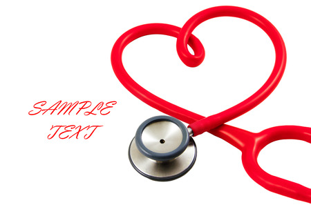 well being: stethoscope in shape of heart, isolated on white