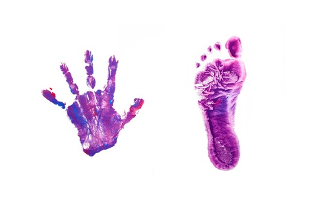 Prints little baby foot and hand. Isolated on white background photo