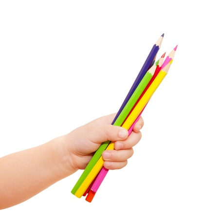 Kids hand holding few pencils.Isolated on white background