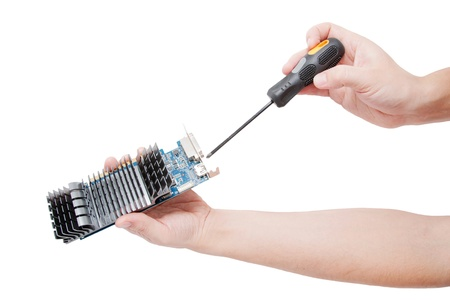 Man's hand repairing video card with screwdriver. Isolated on white background