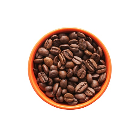 instant coffee: Coffee beans in the orange bowl. Top view.