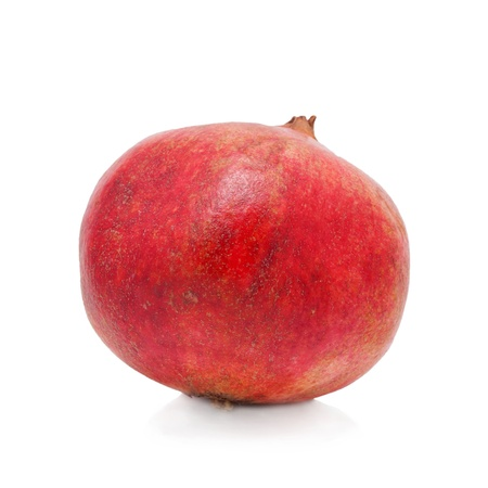 Fresh ripe pomegranate. Isolated on white background.