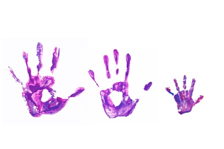 imprints: Purple hand prints of his father, mother and child.  Happy family concept. Isolated on white background. Stock Photo