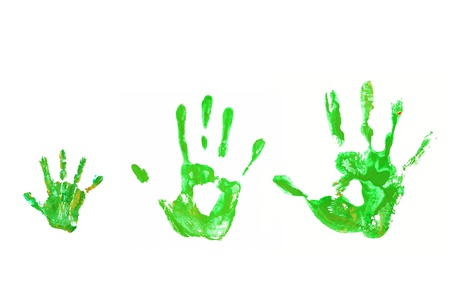 Family and ecology concept. Green hand prints baby, father, mother together. Isolated on white background.