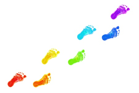 dirty feet: Baby foot prints all colors of the rainbow. The joyful journey. Isolated on white background Stock Photo