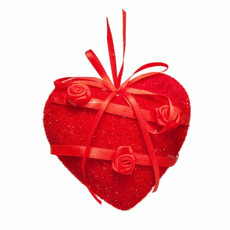 Red heart of fabric and satin, decorated with flowers. Hand Made. Gift with love.  Isolated on white background