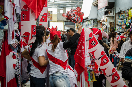 Lima, Peru - OCTOBER 10th 2017: Fanaticism in Peru (Peru vs. Colombia) Russia 2018. Two T-shirts sellers at the Jorge Chavez Market in the district of Surco
