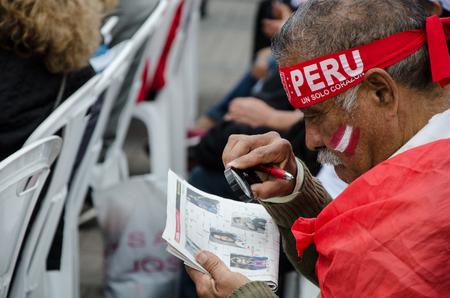 Lima, Peru - OCTOBER 10th 2017: Fanaticism in Peru (Peru vs. Colombia) Russia 2018. Fan reading the newspape