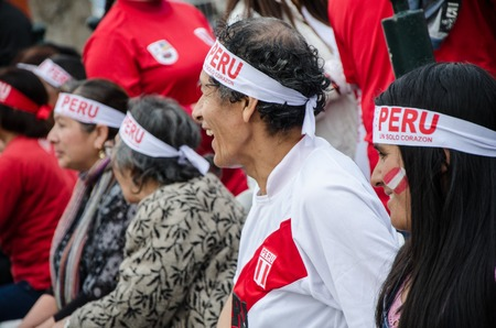 Lima, Peru - OCTOBER 10th 2017: Fanaticism in Peru (Peru vs. Colombia) Russia 2018. Smiling fans before the match in the central square of the district of Surco Editorial