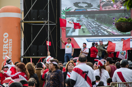 Lima, Peru - OCTOBER 10th 2017: Fanaticism in Peru (Peru vs. Colombia) Russia 2018. Entertainers entertaining the public while awaiting the projection of the soccer party, Plaza de Santiago de Surco - Lima - Peru