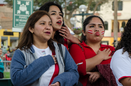 Lima, Peru - OCTOBER 10th 2017: Fanaticism in Peru (Peru vs. Colombia) Russia 2018. Patriots intoning the National Anthem hours before the match between Peru and Colombia Editorial