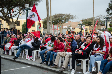Lima, Peru - OCTOBER 10th 2017: Fanaticism in Peru (Peru vs. Colombia) Russia 2018. Peruvian fans waiting for the moment of the match in the Plaza de armas of Santiago de Surco - Lima - Peru