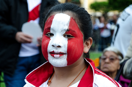 Lima, Peru - OCTOBER 10th 2017: Fanaticism in Peru (Peru vs. Colombia) Russia 2018. Girl with the face painted with the colors of the Peruvian flag Editorial