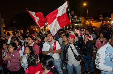 Lima, Peru - OCTOBER 10th 2017: Fanaticism in Peru (Peru vs. Colombia) Russia 2018. fans encouraging the Peruvian team in full swing of match Editorial