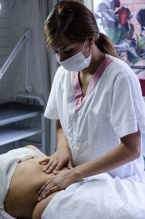Cosmiatra performing reducing massages to a patient Stock Photo