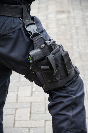 Leg of a policeman in which a firearm is found, concept of security
