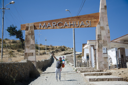 Lima, Peru - 2 SEPTEMBER 2018: Male traveler at the entrance to the road to Marcahuasi located east of the city of Lima - Peru