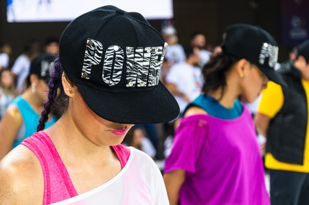 Young woman ready to dance with a cap that says power, concept of woman with courage