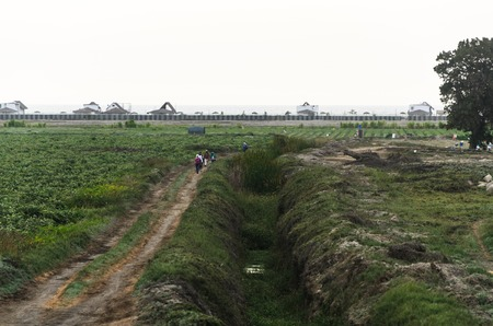 A group of people crossing a field in the south of Lima - Peru