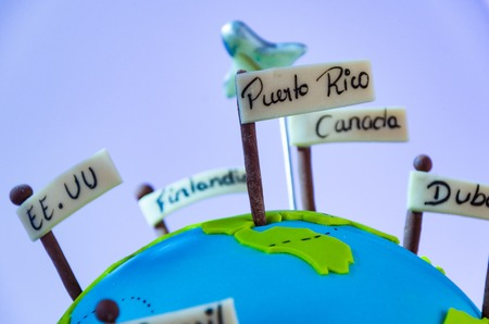 Miniature world with pennants of different countries and small plane, Travel Concept.