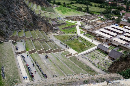 Downtown of the small medieval city of Ollantaytambo, with Inca ruins on Andes Mountains.