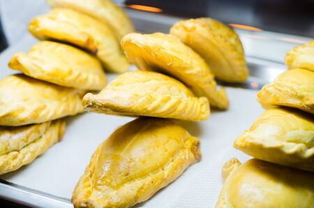 Typical breakfast in Latin American countries, Fried empanadas on wood background Stok Fotoğraf