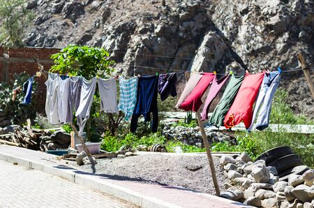 Rope with clean clothes outdoors on laundry day. Stok Fotoğraf