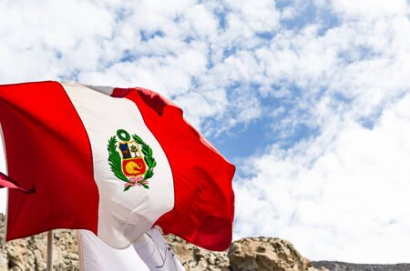 Peruvian flag , blowing in the wind with blue sky on background Stok Fotoğraf