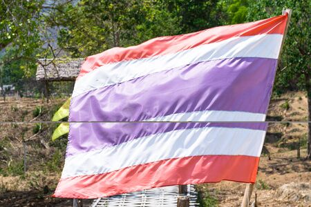 Thailand flag on the longest wooden bridge in Pai - Thailand