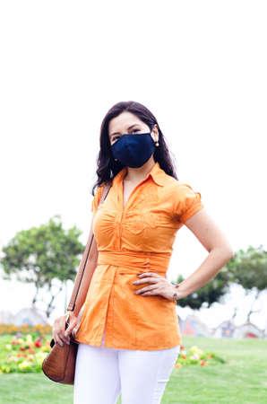 COVID-19 Pandemic Coronavirus Woman in city street wearing mask protective for spreading of disease virus SARS-CoV-2 Standard-Bild