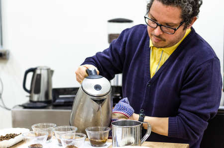 Professional barista testing the taste of a new coffee