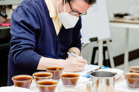 Professional coffee taster testing new smells and flavors