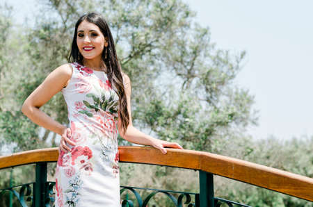 Spring fashion young woman portrait outdoors with trees in background. Beauty Romantic Woman in Flowers. Sensual lady. Beautiful woman enjoying nature. Romantic beauty in fantasy garden