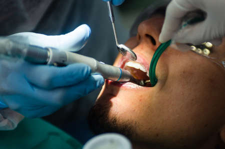 Young male patient takes a dental attendance in the dentists office.
