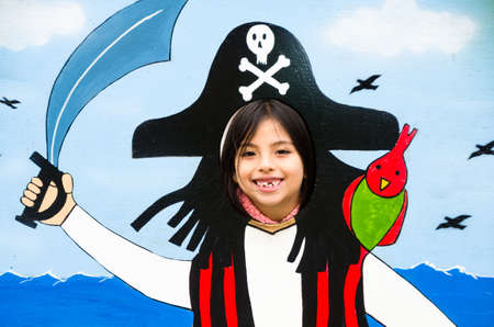Image of a beautiful girl playing make an evil pirate.