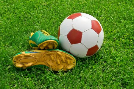 cleats: ball and cleats is on the soccer field