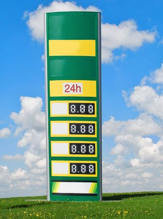 fuel crisis: gasoline prices on a sign with sky and clouds in background Stock Photo