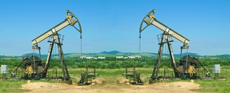 industrially: two oil pump is on a background sky