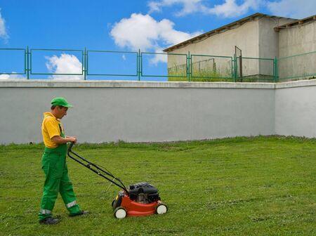 mows: a men mows a lawn a mower