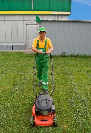 a men mows a lawn a mower Stock Photo - 7547239
