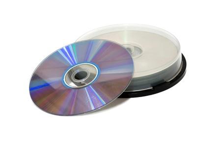 many CDs isolated on the white background photo