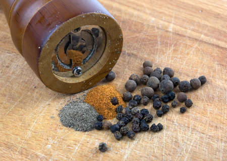 peper: different kinds peppercorns in a wooden spoon Stock Photo