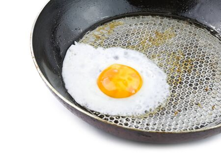 fried egg in an iron skillet on white background Stock Photo - 13143546
