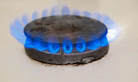 combust: blue gas stove close up