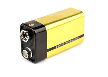 yellow 9v battery is isolated on white Stock Photo - 17093738