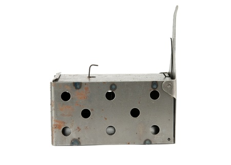 booby trap: metal mousetrap on a white background