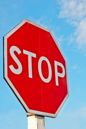 signal: stop sign with a cloudy sky  Stock Photo